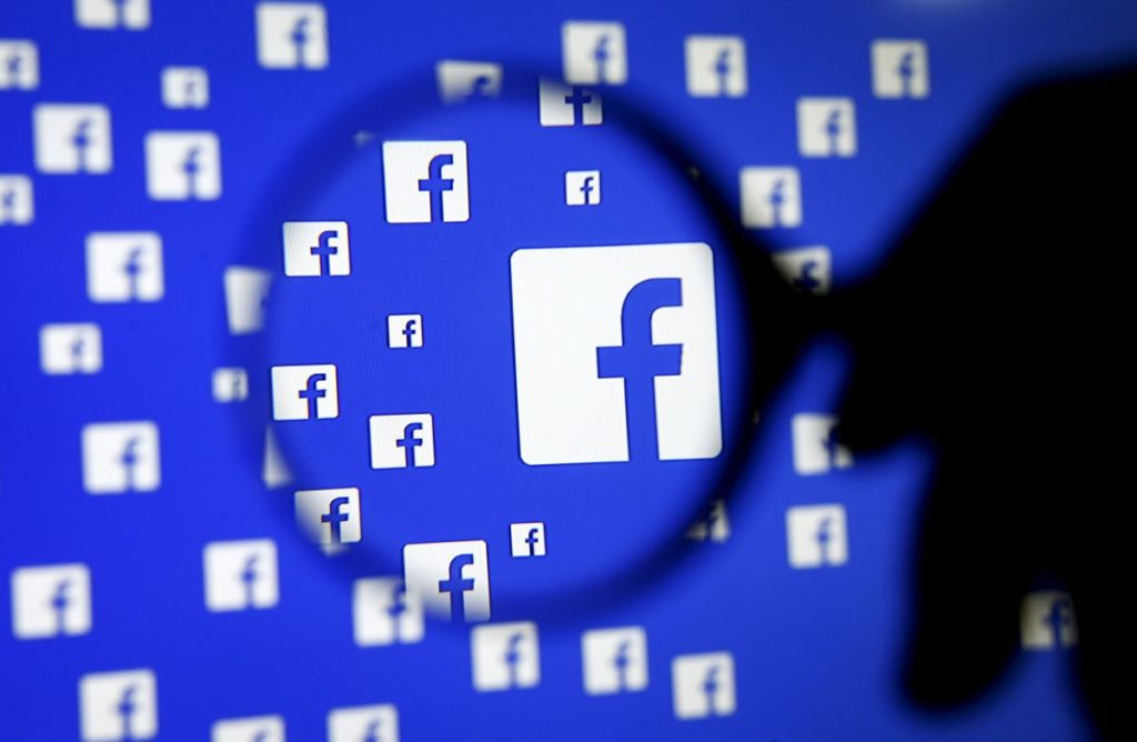"A man poses with a magnifier in front of a Facebook logo on display in this illustration taken in Sarajevo, Bosnia and Herzegovina, December 16, 2015. REUTERS/Dado Ruvic/Illustration/File Photo GLOBAL BUSINESS WEEK AHEAD PACKAGE - SEARCH ""BUSINESS WEEK AHEAD JULY 25"" FOR ALL IMAGES"